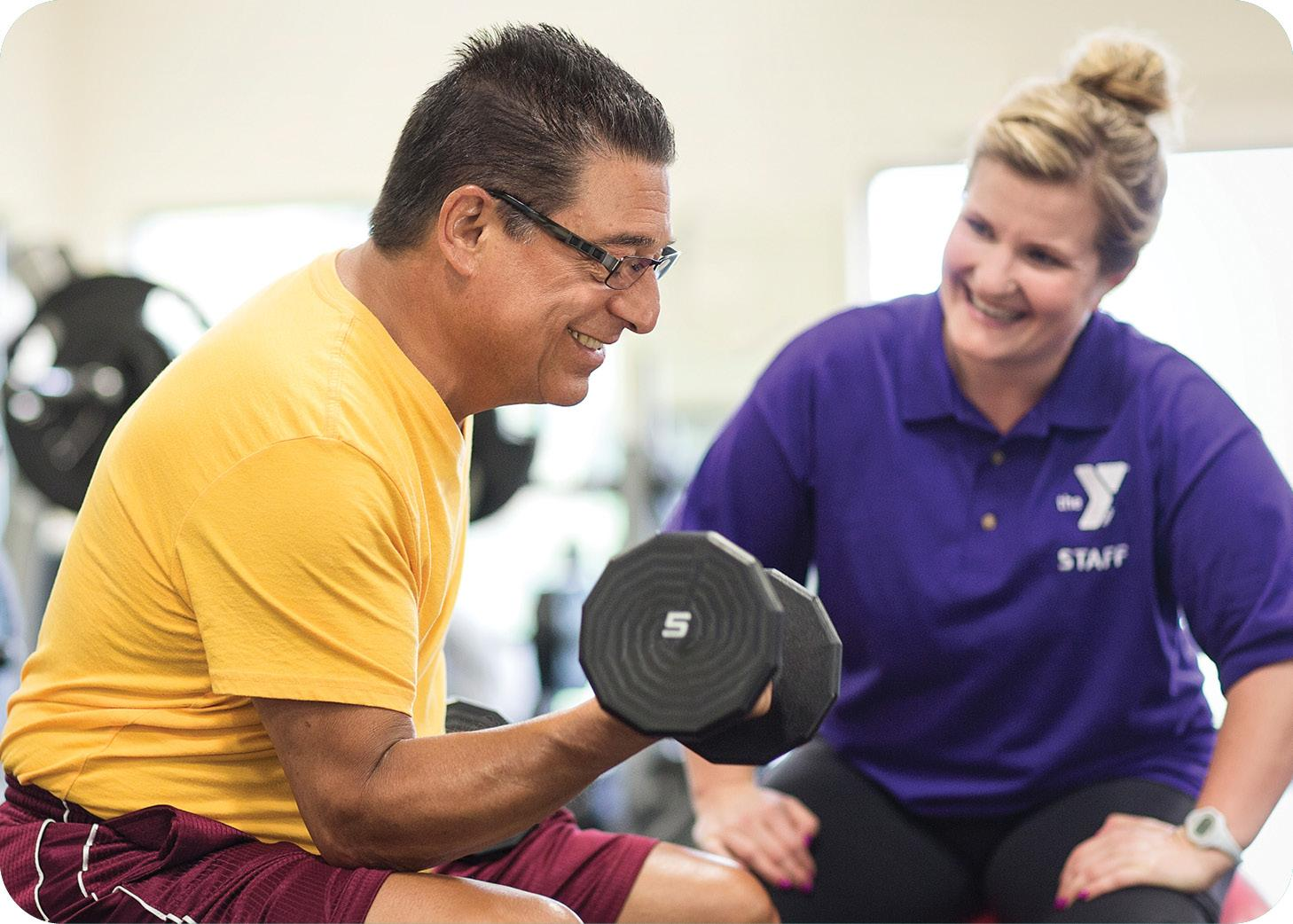 Personal Trainer working with a client